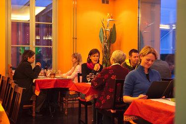 im Srignags-Restaurant verbringen Sie gemütliche Stunden.
